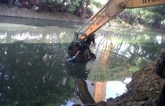 Mayat Pemuda Mengambang di Sungai, Penuh Luka - JPNN.com