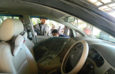 Parkir Mobil Sebentar, Uang Puluhan Juta Rupiah Raib - JPNN.com