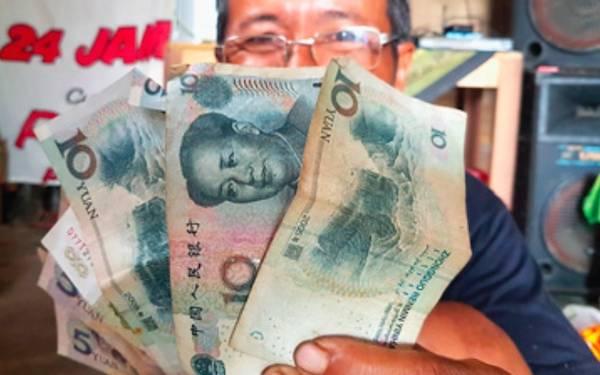 OMG! Mata Uang Tiongkok pun Sudah Beredar di Sulawesi - JPNN.com