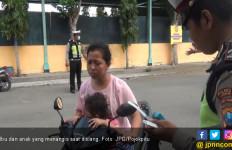 Polisi Bakal Tilang Pengendara Boncengkan Anak tanpa Helm - JPNN.com