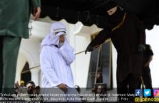 Pasutri Non-Muslim Memilih Dihukum Cambuk - JPNN.com