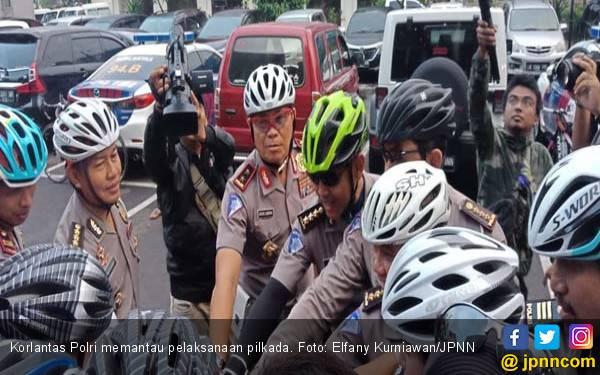 Hari Pencoblosan, Korlantas Pantau TPS dengan Bersepeda - JPNN.com
