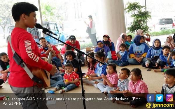 Begini Cara AXIC Peringati Hari Anak Nasional - JPNN.com