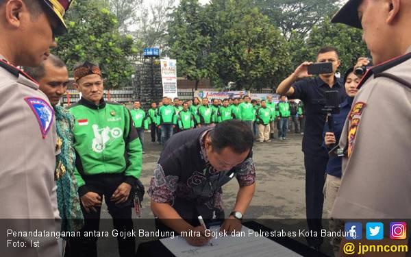 Tingkatkan Keamanan Berlalu Lintas, 400 Mitra Gojek Jadi Relawan Kamtibmas - JPNN.com