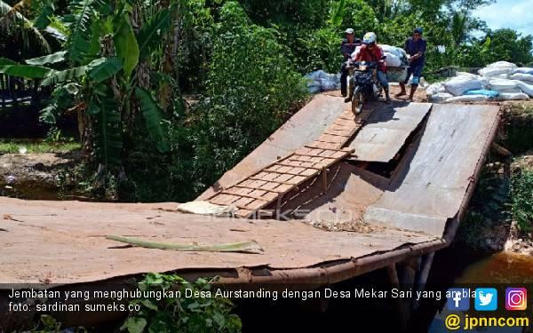 Jembatan di Pemulutan Amblas, Warga Enam Desa Terancam Terisolir - JPNN.com