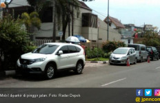 Petugas Gencar Sosialisasi Parkir Ganjil Genap - JPNN.com