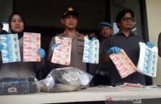 Pasutri Edarkan Uang Palsu Puluhan Juta Rupiah - JPNN.com