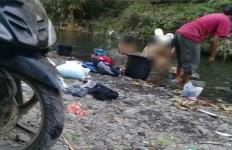 Putu ES Sebarkan Foto Wanita Mandi di Sungai, Bakal Merasakan Akibatnya - JPNN.com