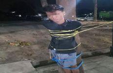 Pemuda Ini Diikat di Pohon karena Mabuk dan Memalak Warga - JPNN.com