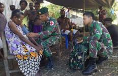 Satgas Yonif 755 Kostrad Mengatasi Permasalahan Kesehatan Masyarakat Hemigoma Papua - JPNN.com