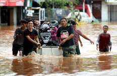 PMJ Berikan Kemudahan Buat Korban Banjir yang Surat Kendaraannya Rusak atau Hilang - JPNN.com