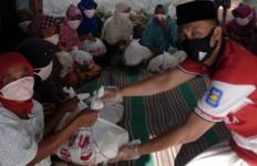 Aksi Mulia Suporter MU di Tengah Pandemi Corona - JPNN.com