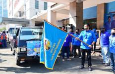 KNPI Donasikan Puluhan Ton Beras kepada Warga Terdampak COVID-19 - JPNN.com
