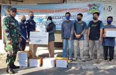 Gandeng Bank Mandiri, Lanal Mataram Bagikan Sembako Kepada Warga Terdampak Covid-19 - JPNN.com