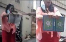 Wanita Lempar dan Ancam Sobek Quran, Ini Kata Kapolres - JPNN.com