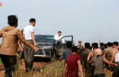 Kim Jong Un Kendarai Mobil Mewah Saat Blusukan ke Daerah Banjir - JPNN.com