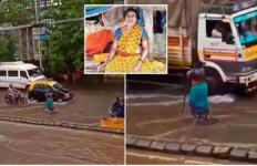 Salut, Wanita Paruh Baya Ini Berjibaku Mengatur Kendaraan Saat Hujan dan Banjir di Jalan Raya - JPNN.com