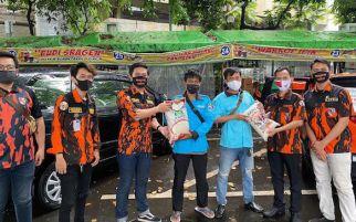 SAPMA Pemuda Pancasila Berbagi Beras dan Masker Kepada Masyarakat Terdampak Covid-19