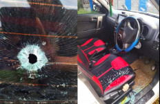 Satu Unit Mobil Ditembak OTK Saat Melintas di Manokwari Papua Barat, Sopir Selamat - JPNN.com