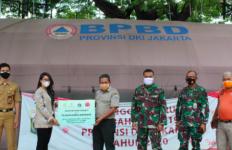Enesis Group Salurkan Vitamin dan Hand Sanitizer kepada Pemprov DKI Jakarta - JPNN.com