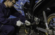 5 Komponen Sepeda Motor yang Harus Diperhatikan Saat Musim Hujan - JPNN.com