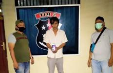 Rudi Eka Wardhana Ditangkap di Padang Saat Lagi Fokus Menulis Angka-Angka - JPNN.com