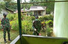 Lihat Nih, Begini Cara Satgas Pamtas Yonif 642/Kapuas Cegah Penyebaran Covid-19 - JPNN.com
