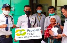 Pegadaian Beri Bantuan untuk Warga Terdampak Banjir di Jawa Barat - JPNN.com