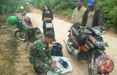 Jalan Tikus Perbatasan RI-Malaysia Rawan Penyelundupan, Satgas TNI tidak Tinggal Diam - JPNN.com