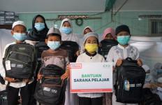 NU Care dan Alfamart Salurkan Paket Belajar untuk Siswa Yatim dan Duafa - JPNN.com