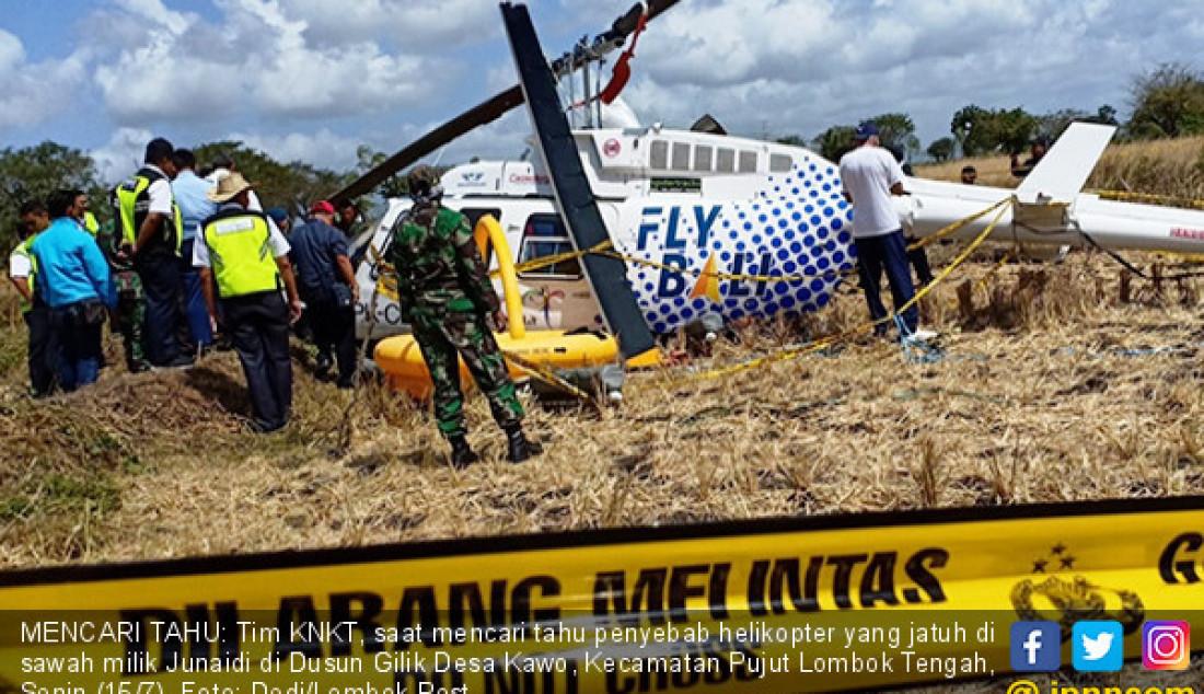 MENCARI TAHU: Tim KNKT, saat mencari tahu penyebab helikopter yang jatuh di sawah milik Junaidi di Dusun Gilik Desa Kawo, Kecamatan Pujut Lombok Tengah, Senin (15/7). Foto: Dedi/Lombok Post - JPNN.com