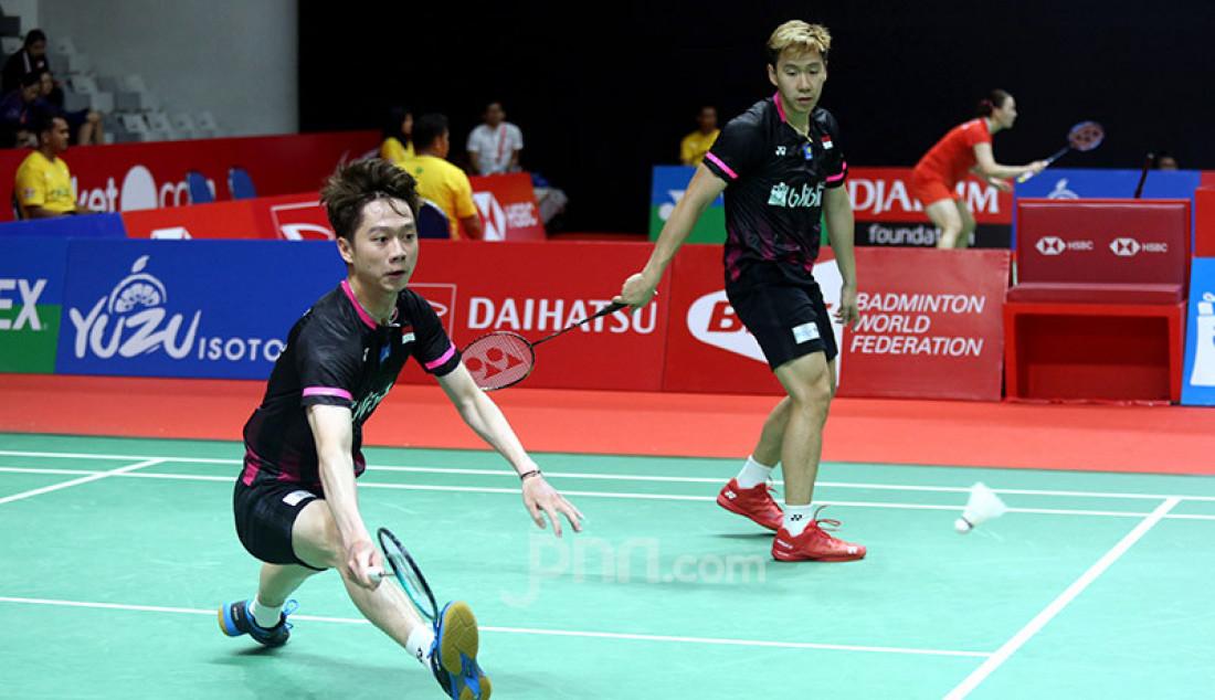 Ganda putra Indonesia Marcus Fernaldi Gideon dan Kevin Sanjaya Sukamuljo saat bertanding pada turnamen Indonesia Masters 2020, Jakarta, Kamis (16/1). Polii dan Apriyani menang atas lawannya dengan skor 21-19 dan 21-13. Foto: Ricardo - JPNN.com