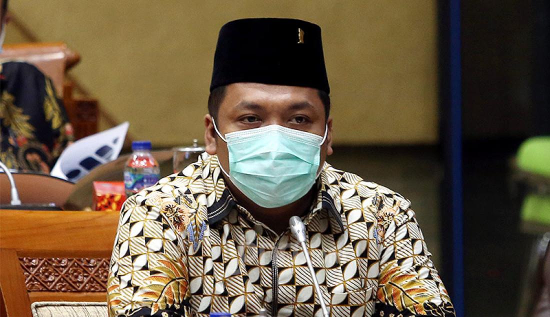 Anggota Komisi IX DPR Muchamad Nabil Haroen mengikuti rapat kerja dengan Menaker Ida Fauziyah, Jakarta, Senin (21/9). Rapat ini membahas penyesuaian RKA K/L Tahun 2021 sesuai Hasil Pembahasan dari Badan Anggaran DPR RI. Foto: Ricardo - JPNN.com