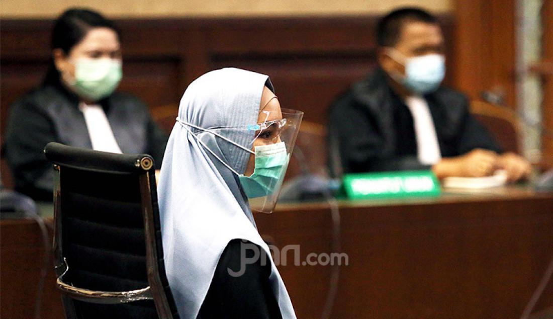 Terdakwa kasus suap pengurusan pengajuan fatwa Mahkamah Agung (MA) untuk membebaskan Djoko Tjandra, Pinangki Sirna Malasari menjalani sidang Eksepsi di Pengadilan Tipikor, Jakarta, Rabu (30/9). Foto: Ricardo - JPNN.com