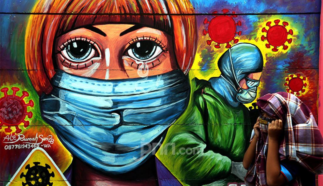Mural bertema Covid-19 di kawasan Tanah Tinggi, Tangerang, Banten, Rabu (20/1) guna mengingatkan masyarakat akan bahaya penyakit akibat virus corona jenis baru tersebut. Foto: Ricardo - JPNN.com
